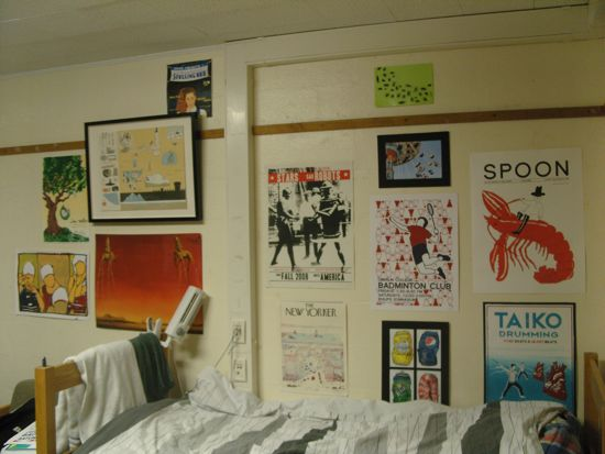 Dorm room wall with posters including Taiko Drumming, Badminton Club, and The New Yorker.