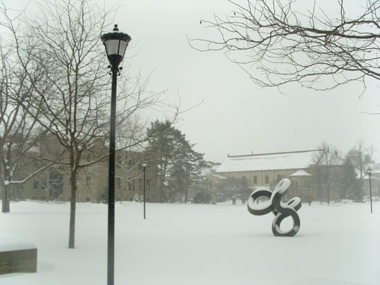 A snowy yard in front of the Science Center