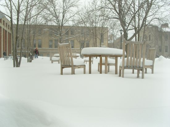 Tables in front of the Science Center covered in snow
