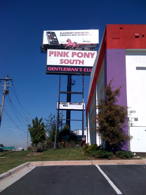 "Highway sign: ""Pink Pony South Gentleman's Club"""