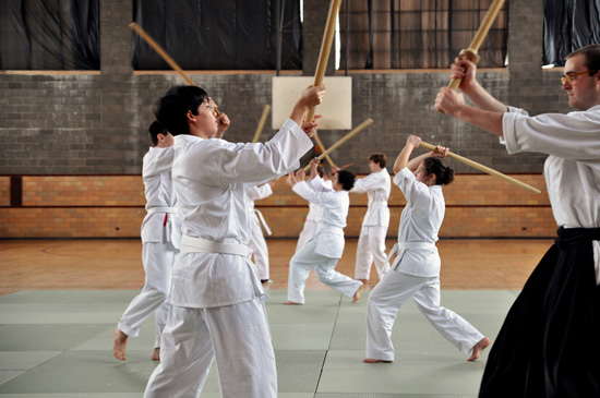 In this exercise, students are paired off with swords raised, ready to strike
