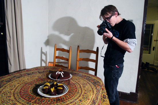 Someone taking a picture of a plate of cupcakes