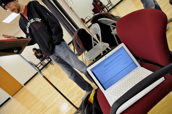An open laptop on a chair during rehearsal