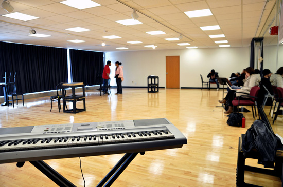 Another view of rehearsal. There is an electronic keyboard in the foreground.