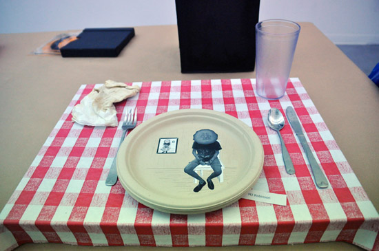 An art installation of a place setting on a table