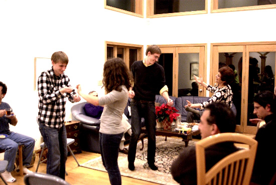 People dance in a living room