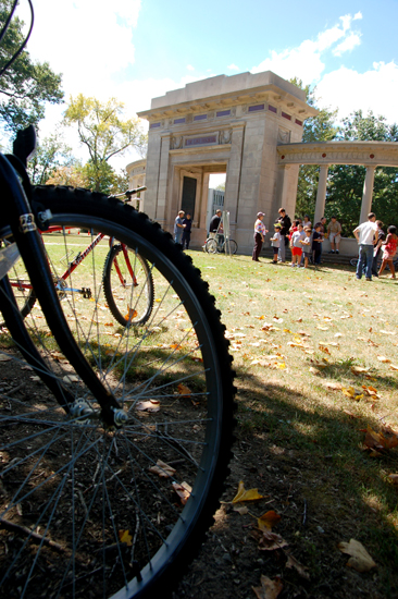 A bike tire obstructing a view of the memorial arch