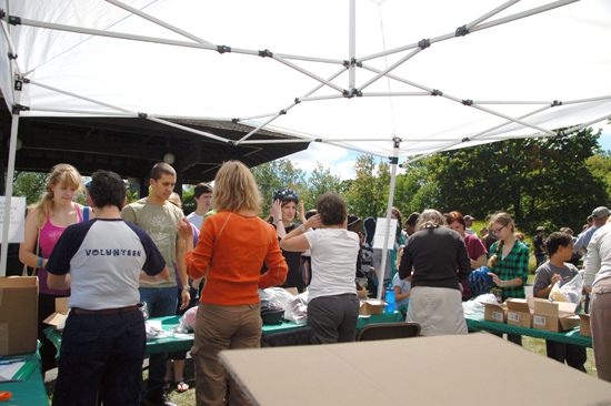 Volunteers under a tent in Tappan square