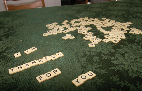 "scrabble tiles spelling out ""I am thankful for you"""