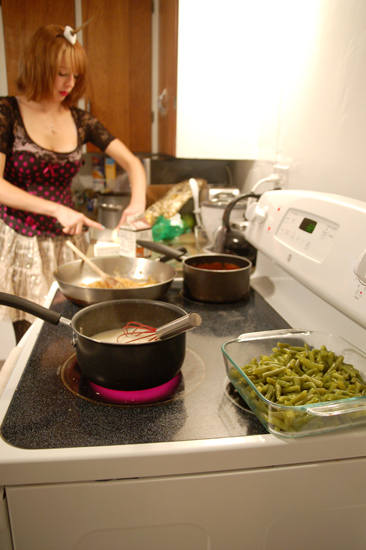 A student cooking in a kitchen