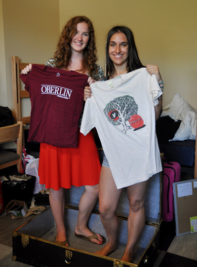 2 people holding Oberlin tee shirts