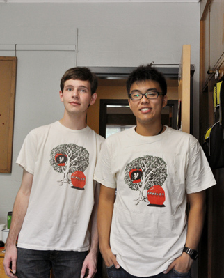 Two students wearing their new tee shirts