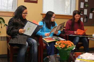 3 prospective students reading admissions materials.