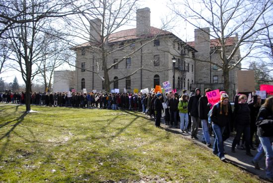 The crowd marches past Wilder Hall