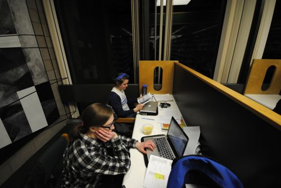 A two person study carrel with students working