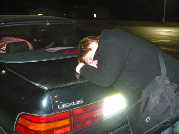 Author laying on car hood