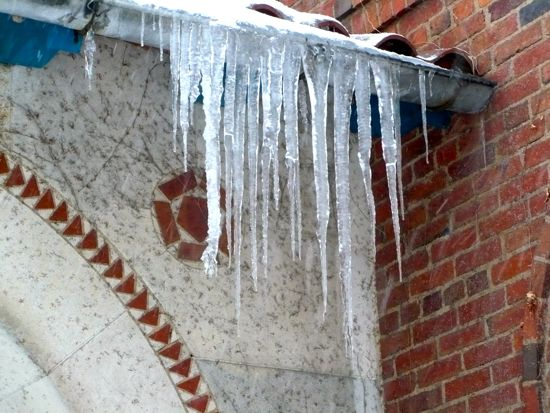 Icicles hanging from a roof drain