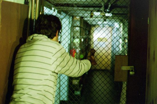 A student in front of a caged off door