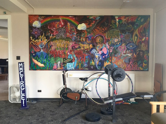 Exercise equipment beside a mural