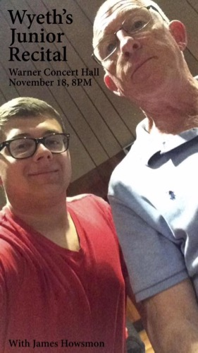 A student takes a selfie with a professor