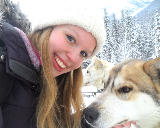 a student takes a selfie with a husky