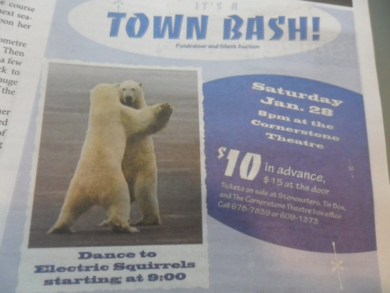 An advertisement in the newspaper for a Town Bash. Two polar bears are dancing with the caption: Dance to Electric Squirrels starting at 9:00