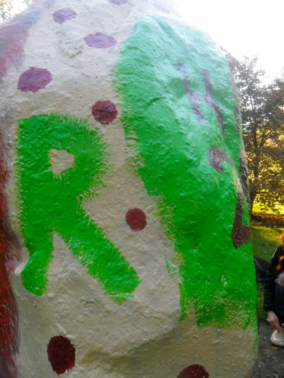 A close up of the spray painted rock