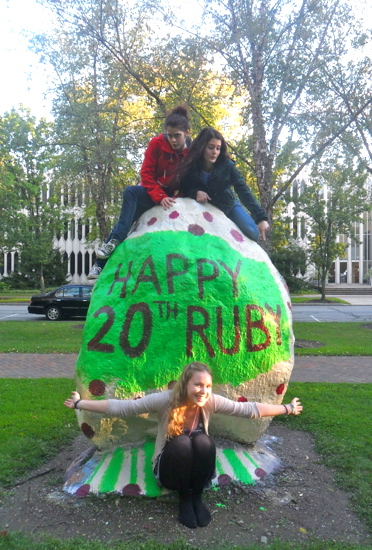 Students sit atop the rock