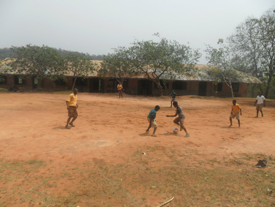 A group of students playing soccer