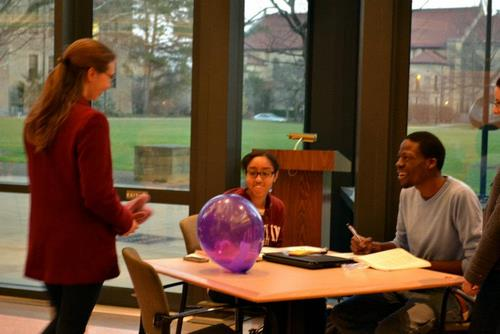 Students sitting at a table in the Science center atrium