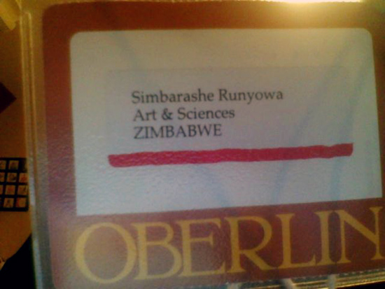 A name tag with the Oberlin logo has a label: Simbarashe Runyowa, Arts & Sciences, Zimbabwe