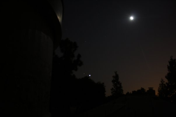 A dark sky with three stars in sight
