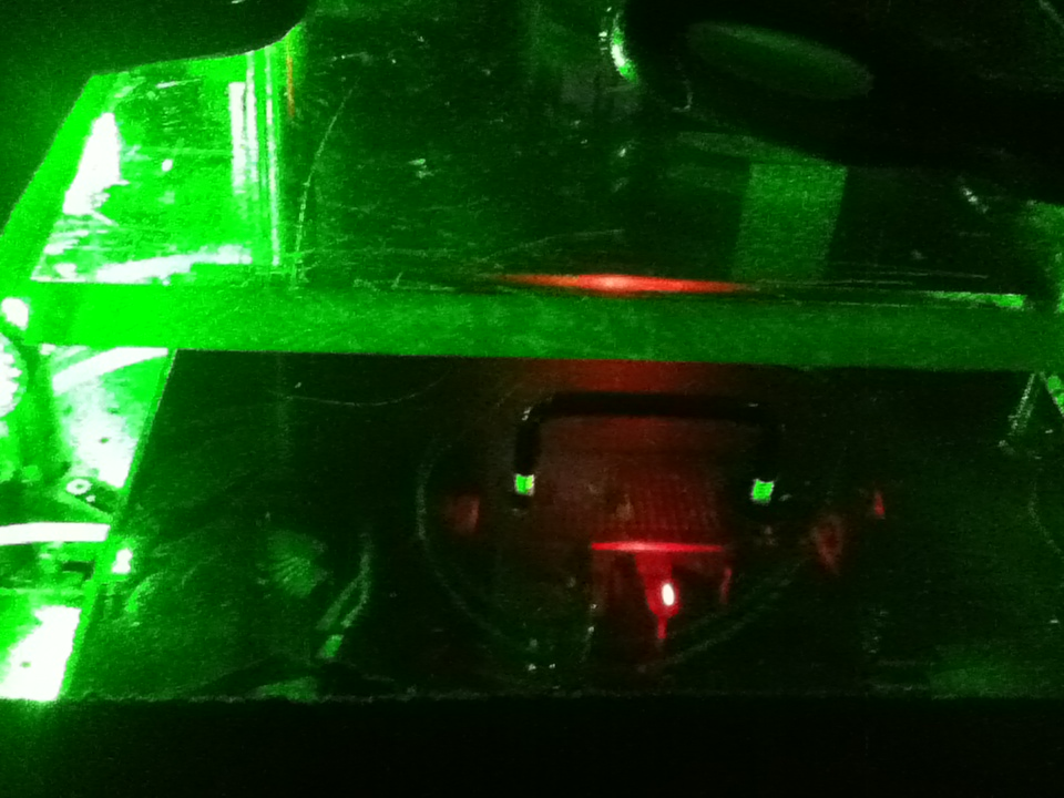 A green glow surrounds a red light.