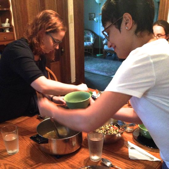 Two people serve a meal in a blur of activity