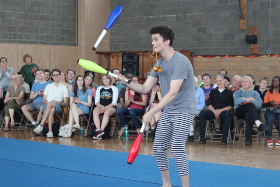 A performer juggles