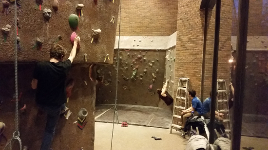 A climber begins to descend a wall