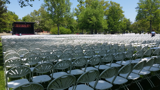 Rows of empty chairs in front of the Commencement stage