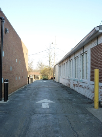The alleyway between Northwest Bank and Oberlin Kitchen