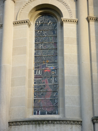 A stained glass window of Fairchild Chapel