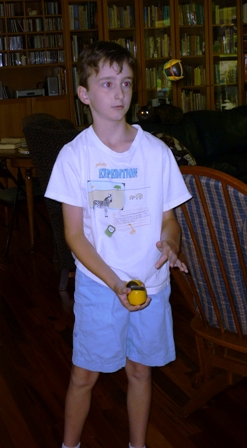 A boy of about 10 with juggling balls