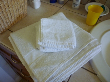 Folded towel and wash cloths