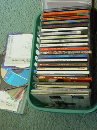 Music CDs spilling out of an overfilled basket