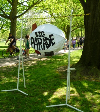 A sign reading 'Big Parade'.