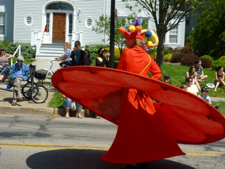 A whirling dervish passes by some parade watchers.