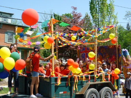 A float with lots of kids and balloons.