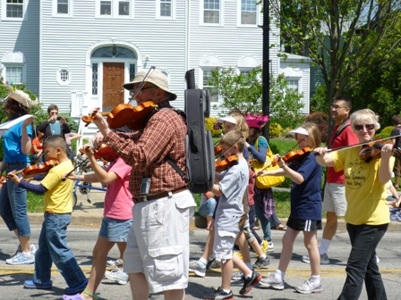 Marching violinists of all ages