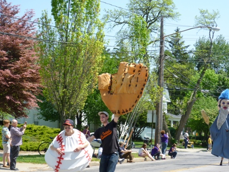 The fielder holds up his giant mitt.