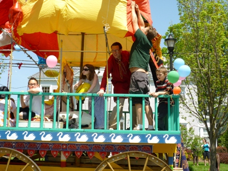 People riding on the Krishna wagon