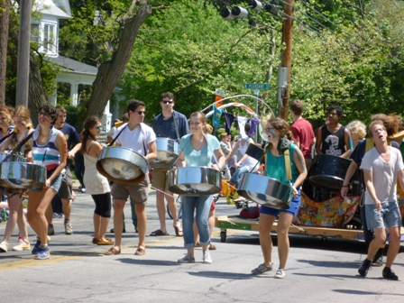Steel drummers play while they march