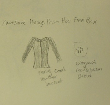 Text: Awesome things from the free box. Image: Shirt and shield
